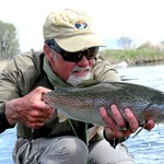Outfitter and guide Michael Stack with a big Beaverhead River Rainbow trout!
